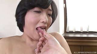 Asian Toyokawa Mutsumi gets her hairy pussy pleased by a dude